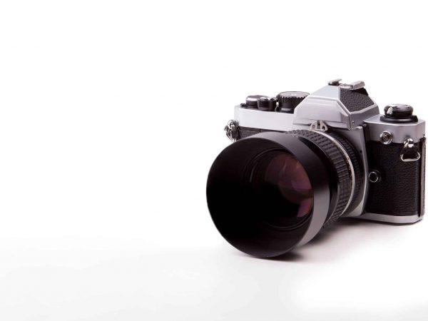 Vintage camera on isolated white background.